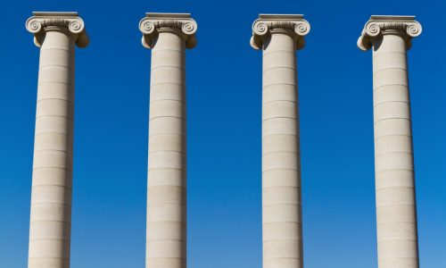 Four massive columns, blue sky